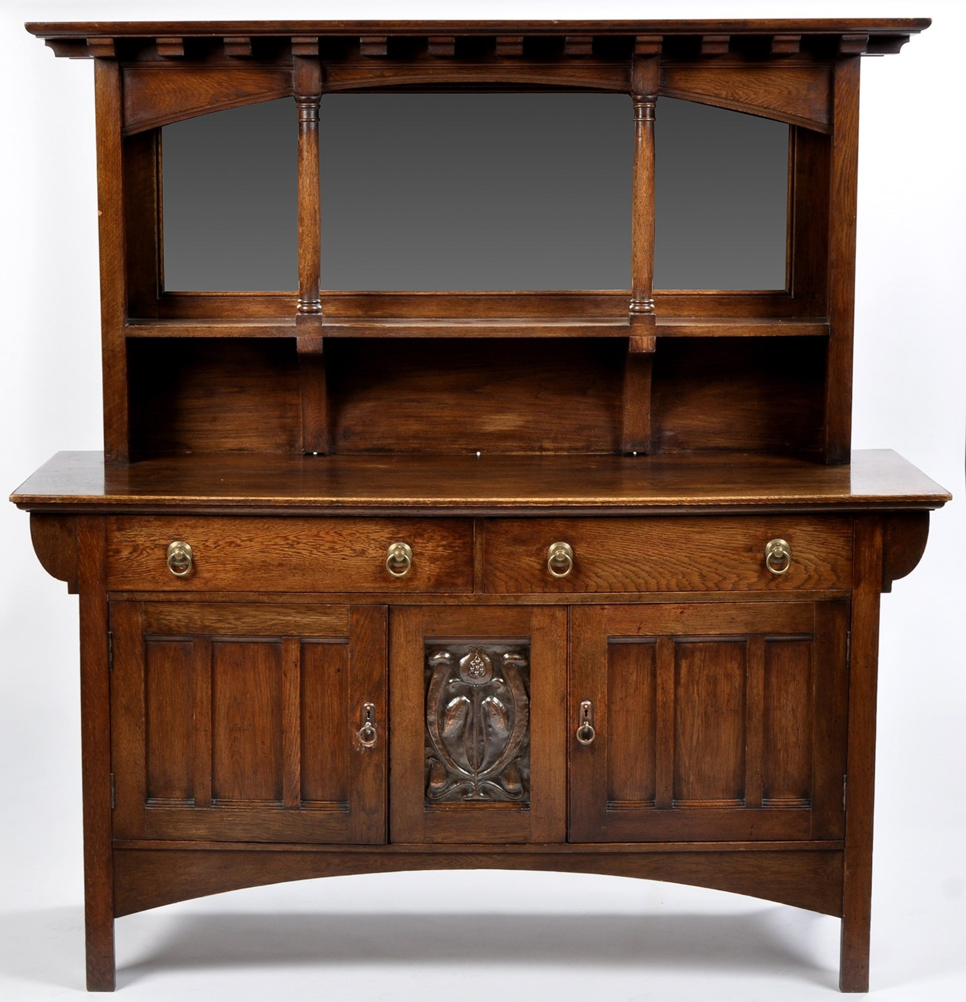 An Arts & Crafts oak sideboard, possibly by Shapland & Petter,