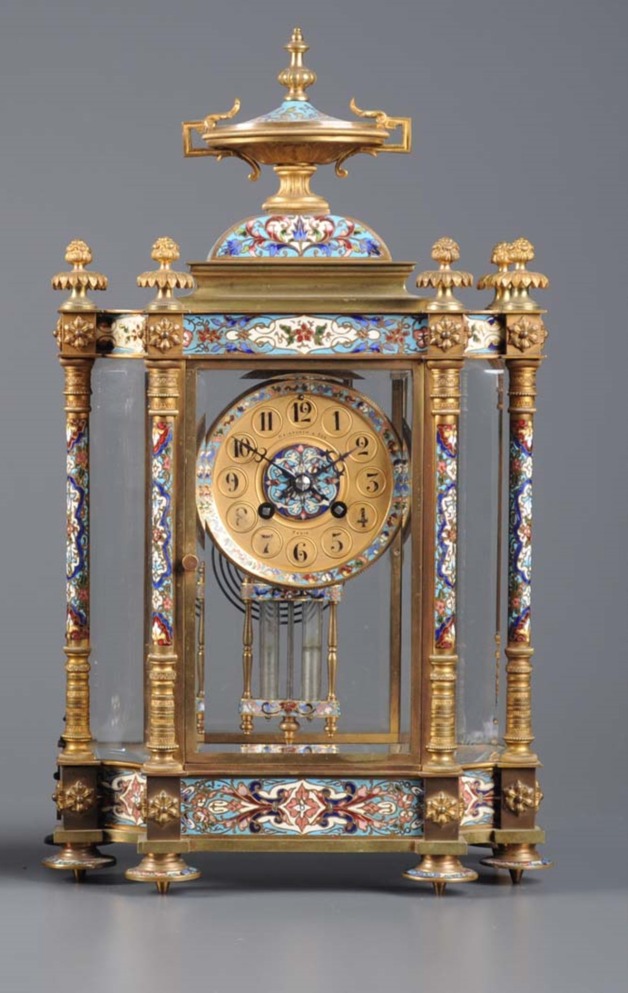 A French gilt metal and cloisonne mantel clock, the circular arabic dial signed 'Rainforth & Son, Paris''
