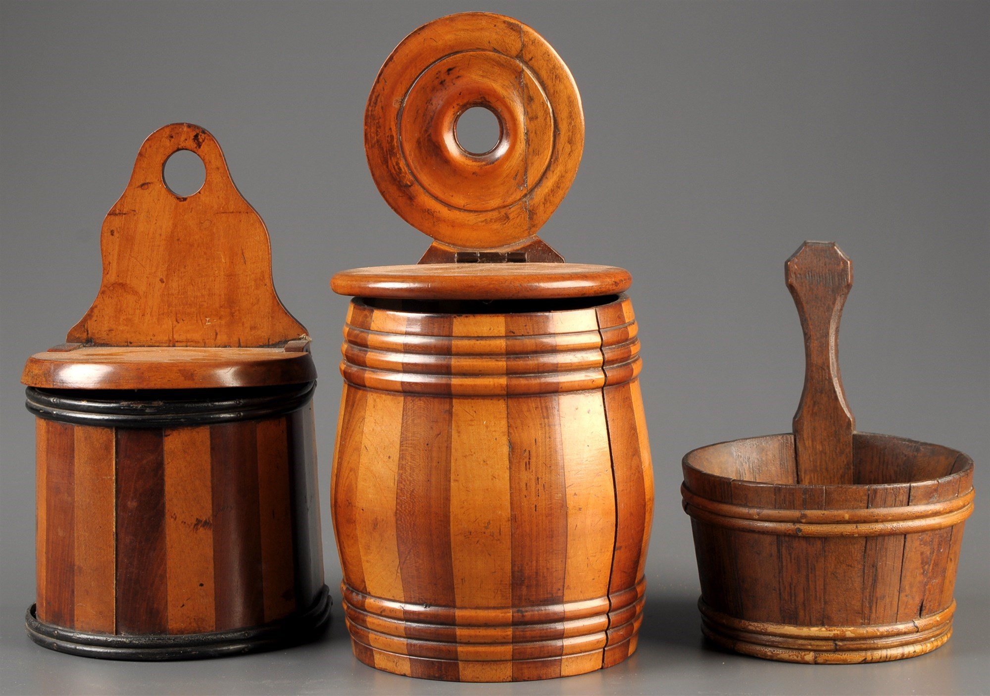 Three  early 19th Century treen wall hanging salt boxes,