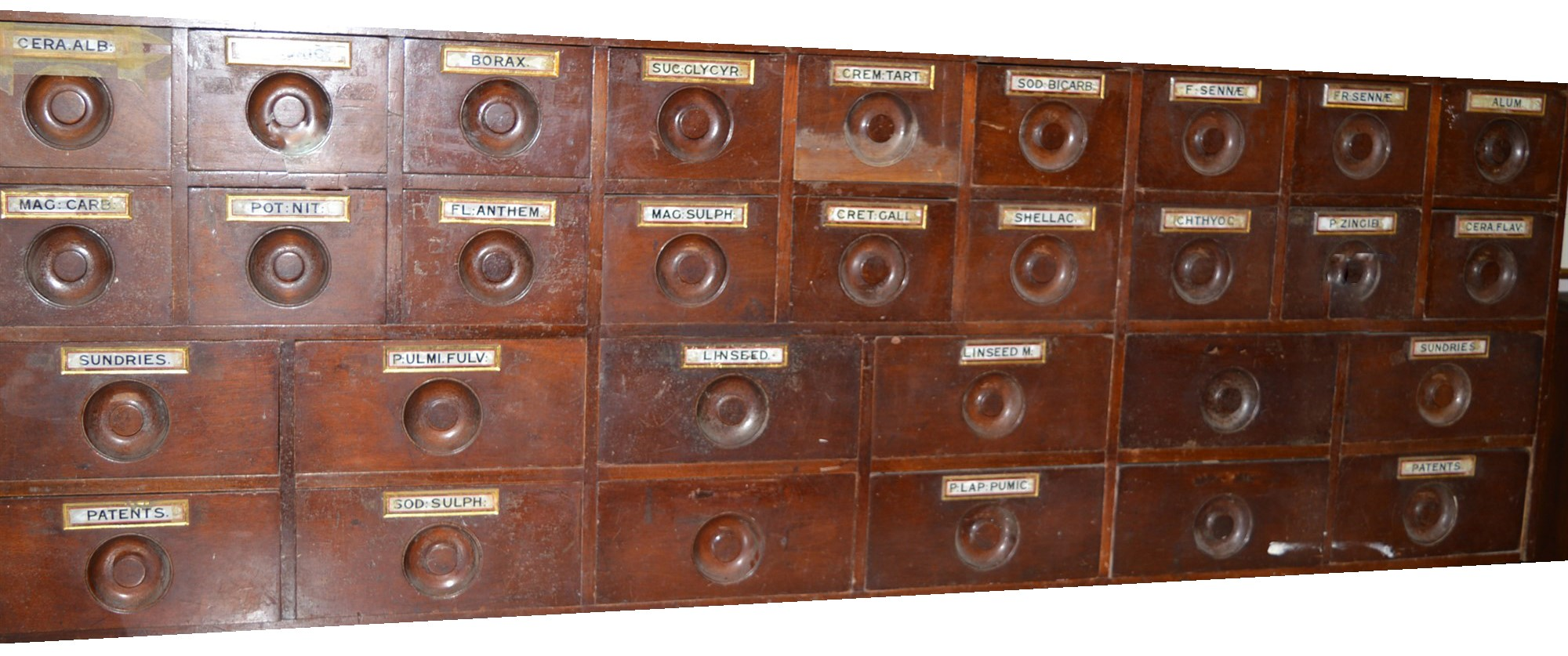 A set of 19th Century mahogany apothecary drawers,