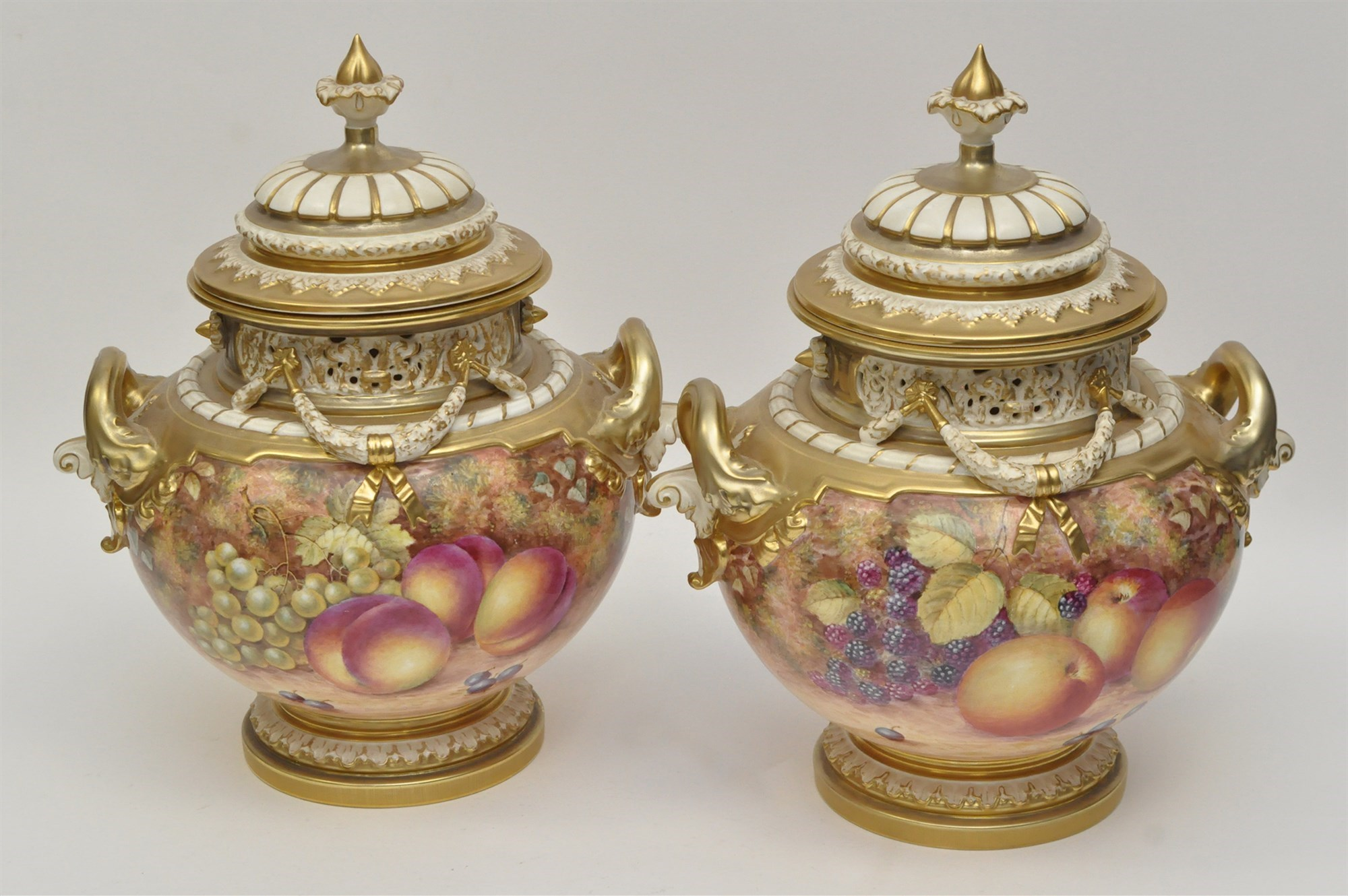 Pair of Royal Worcester vases and covers, signed ''Freeman'',
