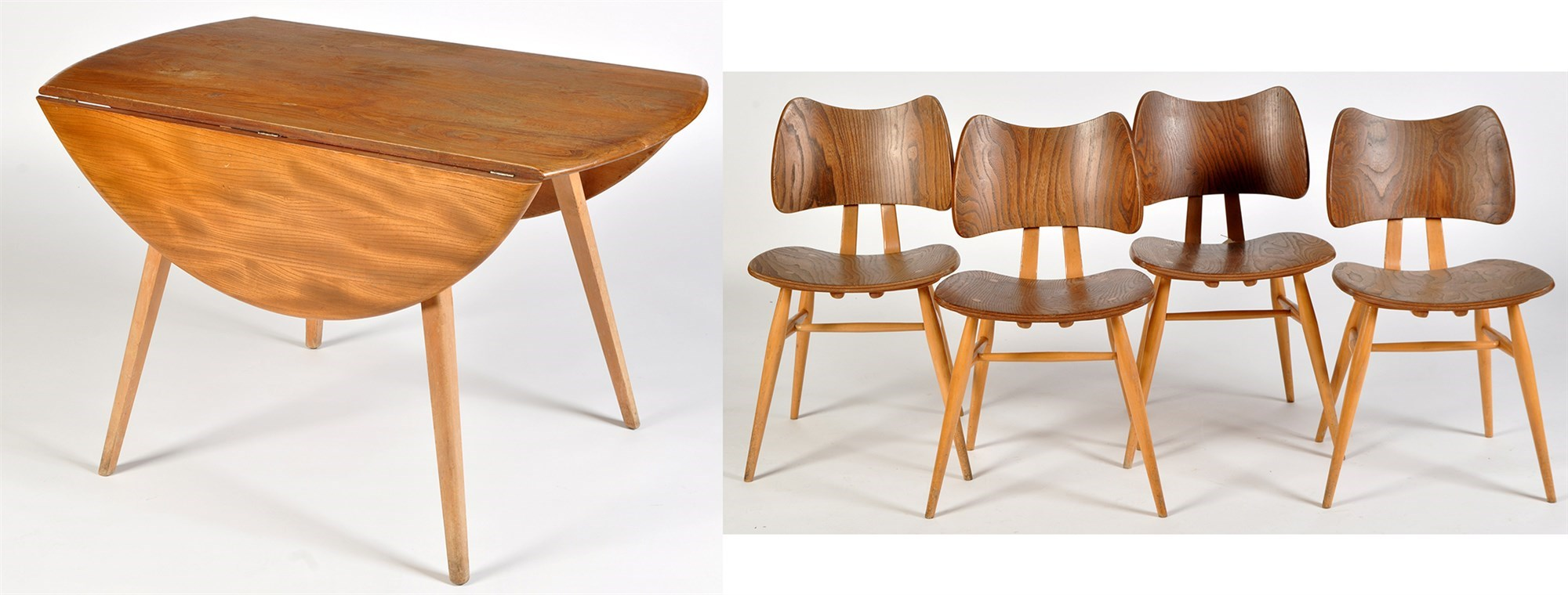 Four Ercol light elm and beech wood butterfly dining chairs; and an Ercol light elm and beech wood drop leaf dining table,
