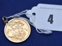Lot 4 - A George V gold sovereign, 1913, in 9ct....