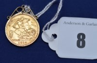 Lot 8 - A George V gold half sovereign, 1913, in 9ct....