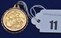 Lot 11 - An Edward VII gold sovereign, 1910, in yellow...
