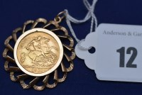 Lot 12 - A George V gold half sovereign, 1911, in 9ct....
