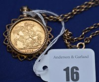 Lot 16 - A Victorian gold sovereign, 1885, in 9ct....