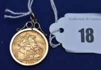 Lot 18 - A George V gold sovereign, 1911, in 9ct....