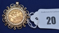 Lot 20 - A George V gold half sovereign, 1911, in 9ct....