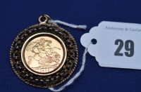 Lot 29 - An Elizabeth II gold sovereign, 1976, in 9ct....