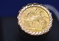 Lot 64 - A Victorian gold sovereign, 1892, in 9ct. gold...