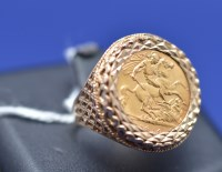 Lot 66 - A George V gold half sovereign, 1914, in 9ct....