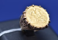 Lot 67 - A George V gold half sovereign, 1914, in 9ct....