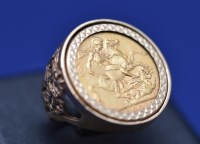Lot 80 - A Victorian gold sovereign, 1901, in 9ct....