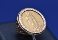 Lot 81 - A Victorian gold sovereign, 1890, in 9ct....