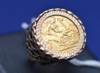Lot 93 - A George V gold sovereign, 1912, in 9ct....