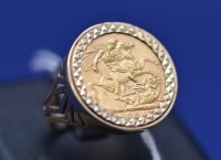 Lot 97 - A Victorian gold sovereign, 1894, in 9ct....