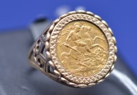 Lot 98 - An Elizabeth II gold half sovereign, 1982, in...