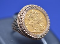 Lot 100 - A George V gold sovereign, 1913, in 9ct....
