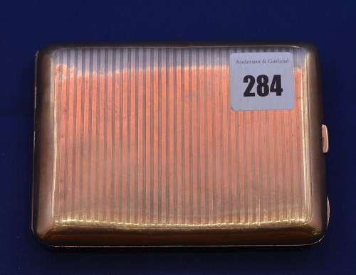 Lot 284 - A 9ct. yellow gold cigarette case, by Clark &...