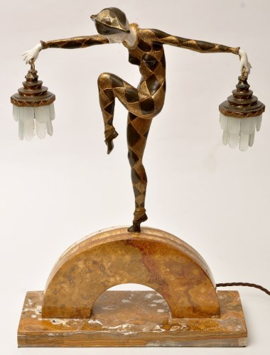 Lot 406-After Marcel Bouraine: an Art Deco patinated,...
