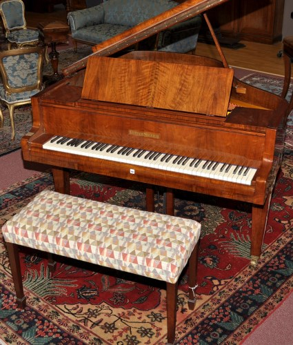 Lot 1057 - A walnut cased baby grand piano, by...