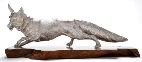 Lot 545-An Elizabeth II large model of a fox, resting on...