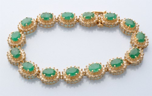 Lot 731-An emerald and diamond bracelet, made up of...