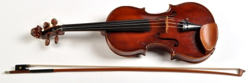 Lot 1043 - A cased violin and bow, the violin labelled...