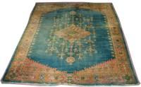 Lot 1110-An antique Ushak carpet, the diamond-shaped...