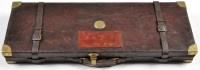 Lot 1065 - A leather on wood car case for a pair of 12...