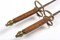 Lot 1072 - Two epee swords, each of the tipped graduated...