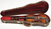 Lot 1123 - A violin, fitted single piece back and label...