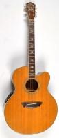 Lot 1125 - A Washburn Cumberland Electro-Acoustic Guitar,...