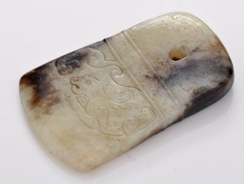 Lot 595-Brown veined celadon jade axehead pendant, the...