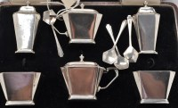 Lot 1037 - A George V condiment set, by Brook & Son and...