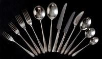 Lot 1041 - An Elizabeth II flatware and cutlery service,...
