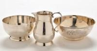 Lot 1048 - An Elizabeth II cream jug and matching sugar...