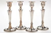 Lot 1052 - A set of four Elizabeth II candlesticks, by...