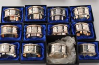 Lot 1055 - A set of twelve Elizabeth II napkin rings, by...