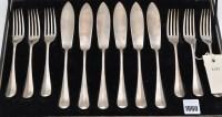 Lot 1060 - Six George V fish knives and six matching...