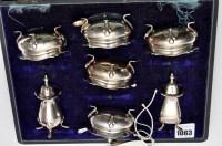 Lot 1063 - A George V condiment set, Birmingham and...