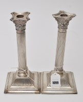 Lot 1099 - A pair of George IV candlesticks, by J....