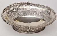 Lot 1117 - A George III pierced oval basket, London 1771,...