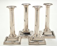 Lot 1120 - A set of four Victorian candlesticks, by...