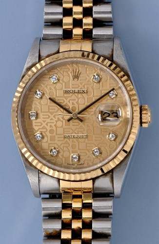 Lot 574-Rolex: a gentleman's datejust Jubilee diamond...
