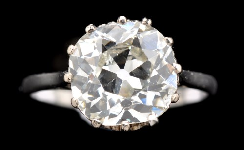 Lot 638-A solitaire diamond ring, the cushion cut diamond ...