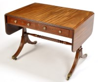 Lot 1259-A Regency mahogany sofa table, the top with drop...