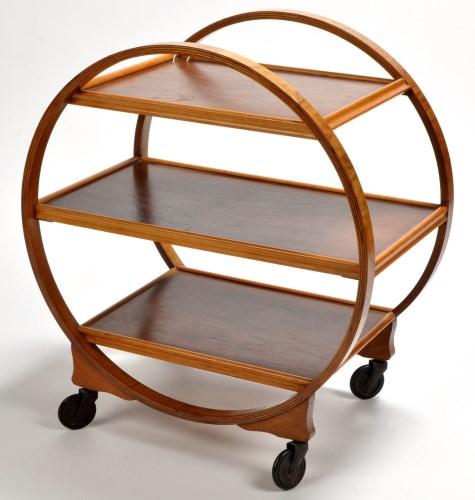 Lot 146 - An Art Deco walnut three-tier trolley of...