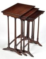 Lot 1065-A nest of three graduated Regency style mahogany...